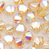 Swarovski Perlen 5328 XILION BEAD Doppelkegel 4 mm crystal AB golden shadow (SF)