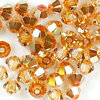 Swarovski Perlen 5328 XILION BEAD Doppelkegel 3 mm crystal metallic sunshine