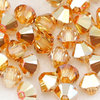 Swarovski Perlen 5328 XILION BEAD Doppelkegel 4 mm crystal metallic sunshine